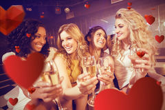 Composite image of pretty girls holding champagne glass Royalty Free Stock Images