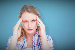 Composite image of pretty hipster with headache Royalty Free Stock Photography