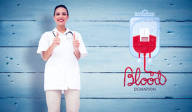 Composite image of pretty nurse giving thumbs up Stock Photos