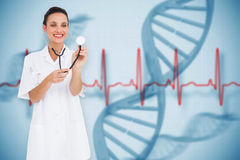 Composite image of pretty nurse listening with stethoscope Royalty Free Stock Photo