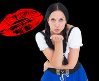 Composite image of pretty oktoberfest girl blowing a kiss Stock Photo