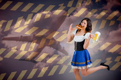 Composite image of pretty oktoberfest girl holding beer tankard and pretzel Stock Image