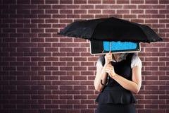 Composite image of pretty redhead businesswoman holding umbrella Stock Photography