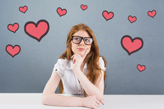 Composite image of pretty redhead thinking and looking up Royalty Free Stock Image