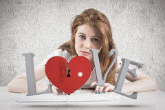 Composite image of pretty redhead typing on keyboard Royalty Free Stock Photos
