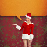 Composite image of pretty santa girl presenting with hand Royalty Free Stock Photography