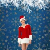 Composite image of pretty santa girl smiling at camera Stock Photo