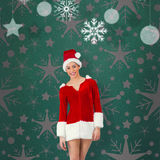 Composite image of pretty santa girl smiling at camera Royalty Free Stock Images