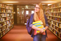 Composite image of pretty student in the library Stock Photography