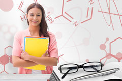 Composite image of pretty student smiling at camera Royalty Free Stock Photo