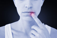 Composite image of pretty woman with finger on lip Stock Photography