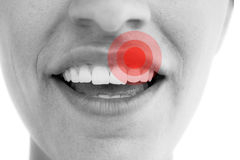 Composite image of pretty woman showing her teeth Stock Images