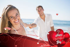 Composite image of pretty woman smiling at camera with boyfriend holding her hand Royalty Free Stock Photography