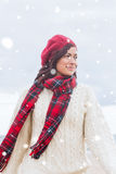 Composite image of pretty woman in stylish warm clothing looking away Stock Photos