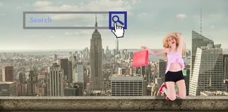 Composite image of pretty young blonde holding shopping bags Stock Photo