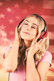 Composite image of pretty young woman with headphones Royalty Free Stock Photo
