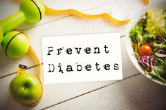 Composite image of prevent diabetes. Prevent diabetes against healthy food with measure tape Stock Photos