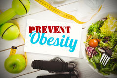 Composite image of prevent obesity. Prevent obesity against indicators of healthy lifestyle Royalty Free Stock Photography