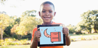 Composite image of print. Print against portrait of boy smiling while holding digital tablet Royalty Free Stock Images