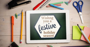 Composite image of print wishng you a festive holiday season Stock Images