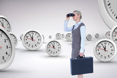 Composite image of profile of a businesswoman using a binocular Royalty Free Stock Photos