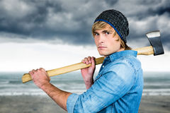 Composite image of profile of hipster standing with axe Royalty Free Stock Image