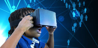 Composite image of profile view of little boy holding virtual glasses Royalty Free Stock Images
