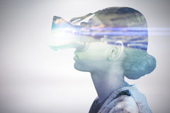 Composite image of profile view of woman wearing virtual reality glasses Stock Images