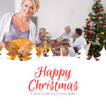 Composite image of proud mother showing roast turkey Stock Photo