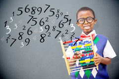 Composite image of pupil with abacus Royalty Free Stock Photo