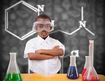 Composite image of pupil conducting science experiment Stock Image