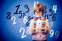 Composite image of pupil holding abacus Royalty Free Stock Photography