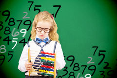 Composite image of pupil holding abacus at elementary school Royalty Free Stock Photo