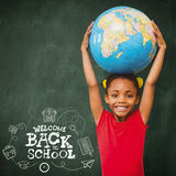 Composite image of pupil holding globe Royalty Free Stock Image
