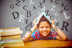 Composite image of pupil with many books Royalty Free Stock Photo