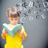 Composite image of pupil reading book Stock Image