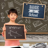 Composite image of pupil showing chalkboard Royalty Free Stock Images