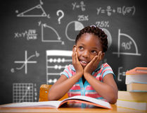 Composite image of pupil sitting at her desk Stock Image