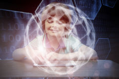 Composite image of pupil using tablet pc. Pupil using tablet pc against black background with shiny hexagons Stock Photography