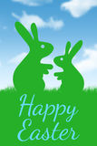 Composite image of rabbits on a grass Royalty Free Stock Photos