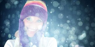 Composite image of radiant young woman with cap and gloves in the winter stock images