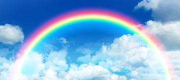 Composite image of composite image of rainbow. Composite image of rainbow against idyllic view of clouds against sky stock photos