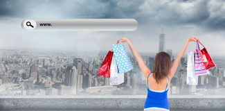 Composite image of rear view of a brunette woman raising shopping bags Stock Photography