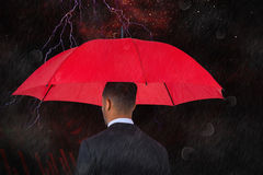 Composite image of rear view of businessman carrying red umbrella Royalty Free Stock Photography