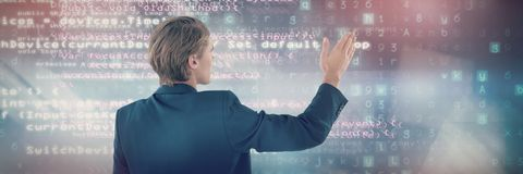 Composite image of rear view of businessman gesturing during presentation. Rear view of businessman gesturing during presentation against code Royalty Free Stock Photography