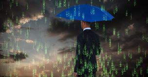 Composite image of rear view of businessman holding blue umbrella and briefcase. Rear view of businessman holding blue umbrella and briefcase against blue and Royalty Free Stock Photo