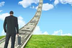 Composite image of rear view of businessman holding a briefcase Royalty Free Stock Image