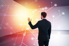Composite image of rear view of businessman pretending to touch invisible screen Royalty Free Stock Images