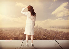 Composite image of rear view of businesswoman. Rear view of businesswoman against new york stock photo