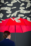 Composite image of rear view of businesswoman carrying red umbrella Royalty Free Stock Image
